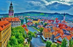 State Castle and Chateau Český Krumlov, Český Krumlov, Czech Republic - Cesky Krumlov city from the castle - wrapped around by the Vlatava river - which acted as a moat and protected the city during wars. Another stunning view of this beautiful city! #stunningstructures #ceskykrumlov #czechrepublic