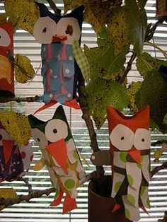 owl sculptures -maybe cute if the the kids paint there own patterns using texture painting w/odd objects... note to self - scroll down page for cool art display option
