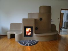 """Russian stove"" beautiful, warm, saves wood, & architecturally astounding."