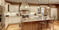 New Kitchen Island? Some Things to Consider - Joseph Kitchen & Bath Modern Kitchen Renovation, Home Renovation, Kitchen Remodel, Kitchen And Bath, New Kitchen, Joseph Kitchen, White Kitchen Island, Painting Kitchen Cabinets, Custom Cabinets