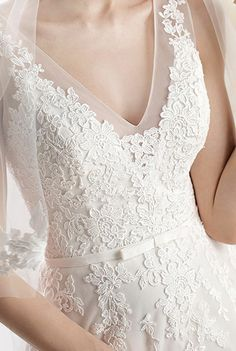 LaSposa I LOVE LOVE LOVE how the lace fades into the sheer fabric and the length of this neckline