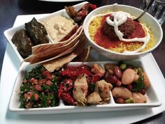 HELSINKI - Hummus, falafel, roasted eggplant, peppers & zucchini, dolmas and tabouleh plate in Helsinki, Finland!