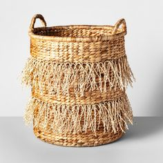 Add a touch of boho-chic style to your space with the Natural Decorative Basket from Opalhouse™. This brown woven basket is made of water hyacinth and palm