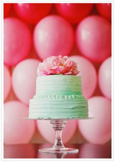 Mint frosted cake and pink peony topper