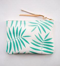 zipper clutch with palm leaf print