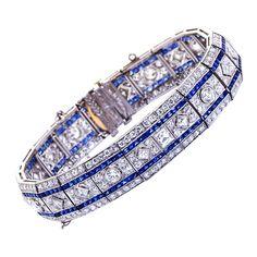Art Deco elaborate diamond and sapphire platinum bracelet.   Exquisite art deco design and detail. (hva)