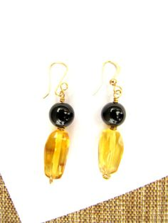 Black and gold Mexican amber earrings from Chiapas, Mexico