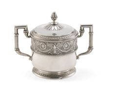 A Fabergé silver sugar bowl, Moscow, 1908-1917 | Lot | Sotheby's -cylindrical with hinged lid and squared reeded handles, the side applied with a frieze of laurel-festooned swans, bud finial, the base rim cast with leaf tips, gilt interior, struck K.Fabergé in Cyrillic beneath the Imperial Warrant, 84 standard height 11.5cm, 4 1/2 in.