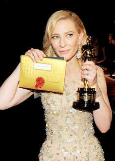 Cate Blanchett poses with her award at the Oscars Governors Ball