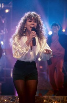 Mariah Carey 1990s-what I find interesting is that early on, it seemed that she would wear something a little tight and revealing but then resort to having to wear a big blouse on top