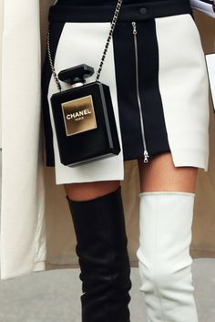 Womens street style fashion Paris fashion week march black and white Chanel outfit with knee high boots, chanel parfum bag, monochrome skirt, pearl necklace, cardigan Fashion Week Paris, Street Fashion, Looks Street Style, Looks Style, My Style, Moda Fashion, Fashion News, Fashion Women, Fashion Fashion