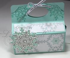 Here is a 3D project I had at my class, and it was a huge hit! We filled them with treats for the go. It is made out of Stampin' Up! Pop 'n Cuts Die, Winter Frost Designer paper and Festive Flurry stamp set. You can do so much with the Die, it would also make a cute Valentines, Easter, Fall or any occasion box. Made by Lisa Bowell-Stampin' Up! Demonstrator @ lisastamps.com