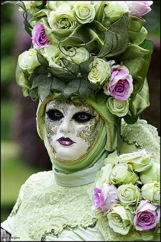I like this...think of attaching fabric to edge of mask to make a covering head piece   Venetian Mask....