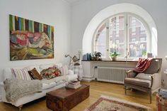Apartamento de estilo nórdico con toques exóticos