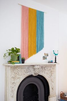 Yarn Wall Art by Oleander + PalmGo bold or go home. The colors of this simple hanging make it work without any weaving.