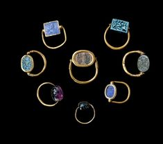 12th Dynasty Scarab finger rings Found at Abydos tom G62 Made from gold, obsidian, amethyst, faience