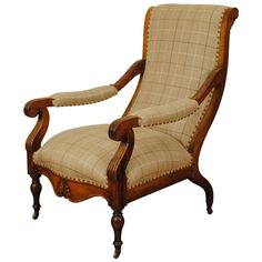Exceptional Mid-19th Century Italian Carved Walnut Library Chair | From a unique collection of antique and modern armchairs at https://www.1stdibs.com/furniture/seating/armchairs/