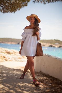 Cute white summer dress. Off the shoulder trend worth colorful sandals and hat