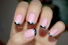 Pink nails with black tips & bows by Jjooyoo