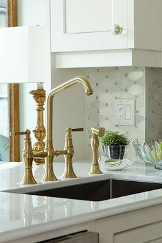 Extend The Colour Palette Throughout The Apartment Even among disparate elements. Here, for example, the brass-toned kitchen faucets pick up on similarly surfaced items elsewhere in the space, from picture frames and mirror edging to lamp and table bases.