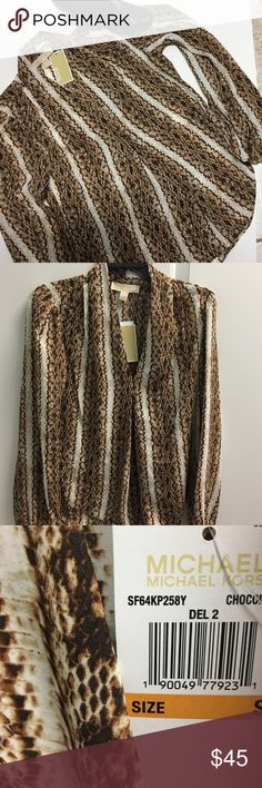 NWT Michael Kors Animal Print Blouse Beautiful V-neck tunic like blouse from Michael Kors size is small but would fit a medium as well Michael Kors Tops Blouses