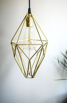 This lamp has two different variations. MATERIAL brass pipes, fishing wire, bulb socket ~ ~ ~ ~ ~ ~ ~ ~ ~ ~ ~~ ~ DIMENSIONS ( Width x Height) Height with cable: ~140 cm Height: 32 cm Diameter: ~18 cm Bulb type: E27 x 1 light  Bulb is not included  You can purchase vintage light bulbs here: https://www.etsy.com/listing/245819416/vintage-light-bulb ~ ~ ~ ~ ~ ~ ~ ~ ~ ~ ~ ~ ~   Perfect for your home, living Room, bedroom, kitchen etc ~ ~ ~ ~ ~ ~ ~ ~ ~ ~ ~~ ~ MORE PHOTOS: ...
