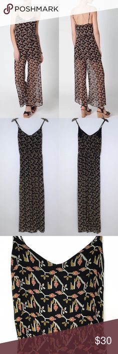 "[Anthropologie] Dolan Rolakan Floral Jumpsuit Silk Rolakan Jumpsuit by Dolan from Anthropologie. Pull on with adjustable spaghetti straps. Retro Floral print. Elastic waist. Lined to mid thigh. Bottom portion of pants are sheer.   🔹Fabric: Silk 🔹Full Length: 56"" 🔹Bust: 34"" 🔹Waist: 28"" 🔹Rise: 12"" 🔹Inseam: 30"" 🔹Condition: Excellent pre-owned condition.   *C18 Anthropologie Pants Jumpsuits & Rompers"