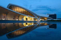 The TWA Flight Center designed by Eero Saarinen at JFK recently reopened as a hotel. Twa Flight Center, Eero Saarinen, Jfk, Architecture, Building, Glass, Travel, Design, Arquitetura