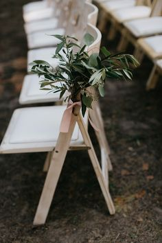 Simple ceremony chair greenery by B-Side Farm & Floral Design.
