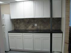 Image from http://www.rtacabinetstore.com/RTA-Kitchen-Cabinets/traditional-white-kitchen-cabinets/cabinets.jpg.