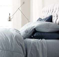 Restoration Hardware - Vintage Chambray Bedding - Any of the available colors would work.  The blue chambray would look cool against an oatmeal/ taupe upholstered headboard!