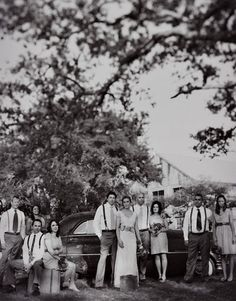 Wedding party in front of an old car