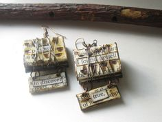 Altered Book Art - Paper Jewelry Earrings - Book Earrings - Writers Jewelry by PaperMemoirs on Etsy https://www.etsy.com/listing/89694821/altered-book-art-paper-jewelry-earrings