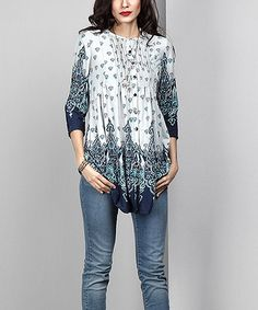 A rounded hem elongates your figure in this business-minded tunic that captivates with a dynamic print.Note: Due to the manner in which the fabric is cut, pattern layouts may vary.Shipping note:  Allow extra time for your special find to ship.