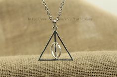 spin the harry potter jewelry silver Deathly Hallows by ruthdreamy