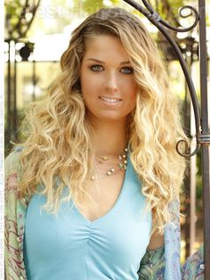 Long blonde wavy hair.