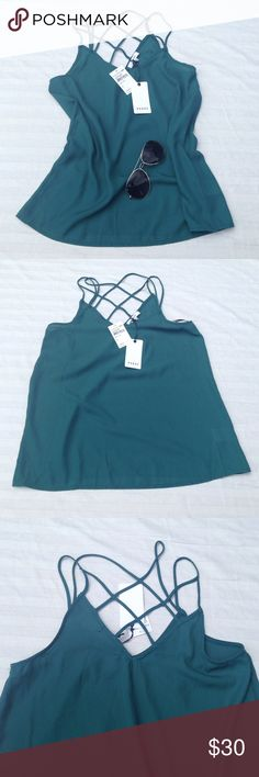 RO&DE silky top Gorgeous teal like color, silky feeling with beautiful strappy detail in the back. Still with tags. From pit to pit appx 17, length appx 26.  Thank you for visiting my closet. :) Please let me know if you have any questions. RO&DE Tops