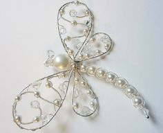 White Freshwater and Swarovski Pearl Dragonfly Hairpin, Brooch or Bouquet DecorationDo the wire swirled down between and the beadsapplicazione con perle e swarovskiEasily could be made with wiring and an old necklaceso delicate a dragonfly Wire Wrapped Jewelry, Wire Jewelry, Beaded Jewelry, Jewelery, Handmade Jewelry, Beaded Crafts, Wire Crafts, Jewelry Crafts, Beaded Ornaments