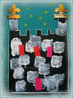 Sur du papier noir, des empreintes de carrés d'éponge, des gommettes et des morceaux de couronne....
