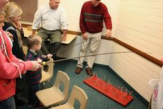 candy cane fishing. Perfect for a toddler christmas party.  Bridgey Widgey: Winter Wonderland Ward Party