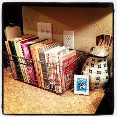 Wire baskets with cookbooks.