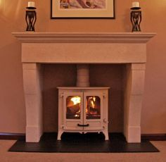 Hand carved English limestone mantel with slate tiled hearth and almond Charnwood Island 1 multi fuel stove. Fitted in Hullbridge Essex 2009 Stone Fireplace Surround, Stone Mantel, Limestone Fireplace, Farmhouse Fireplace, Stove Fireplace, Fireplace Mantels, Fireplaces, Slate Hearth, Multi Fuel Stove