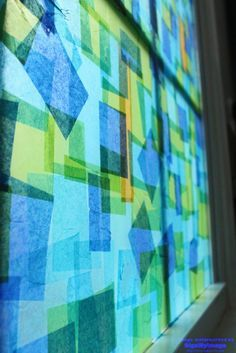 """Tissue paper stained glass window – use a mixture of glue & water to paste tissue paper squares on the window - it's easily taken down when you are ready to start all over again ("""",)"""