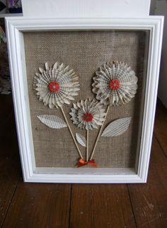 Large box frame with book pages flowers on a hessian backing.