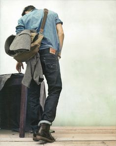 Chambray, Denim, boots, and grey jacket, artfully carried.