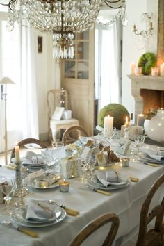 Marie-Paule Faure's Christmas table laid in gold and grey