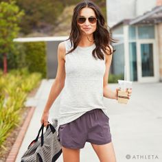 Athleta Summer 2014 LookBook | City Chic. Take your workout from studio to street in performance fabrics revamped with street-cred looks. Shiva Shimmer Tank (available online early June) + Shimmy Short + Cameron Gym Bag. #powertotheshe