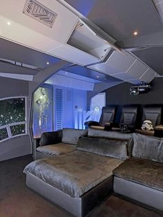 Star Wars themed home theater. Love the bed!