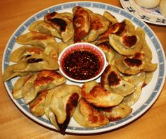Homemade Chinese Pork Potstickers with a Sweet Sesame Chili Soy Sauce for dipping by Jimmy Chung (http://www.twitter.com/JimmyChung).