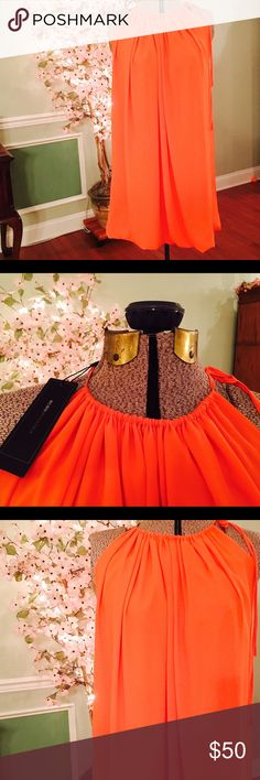 BCBG MAX AZRIA Orange Dress NWT Halter dress with neck tie by BCBG MaxAzria. Brand new with tags. Size small. Tag lists the color as bright orange. The bottom has a slight bubble hem. BCBGMaxAzria Dresses